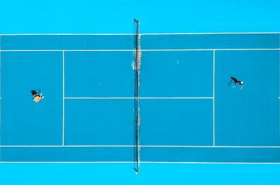 An arial image of a blue tennis court